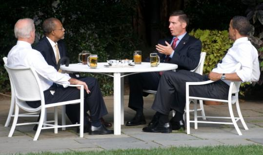 Sergeant James Crowley (second from right) spoke with professor Henry Louis Gates Jr. (second from left) as they had a beer with Vice President Joe Biden and President Obama.