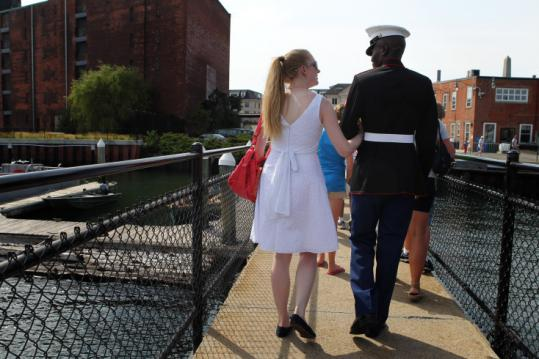 Lianne Smith and Luke Wanami, who just became a US citizen, left the USS Constitution after the ceremony yesterday.