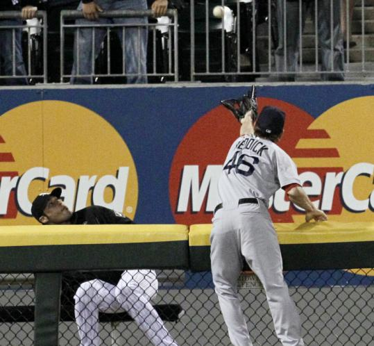 Red Sox left fielder Josh Reddick can't bring back this blast by the White Sox' Carlos Quentin, a two-run homer in the fourth.