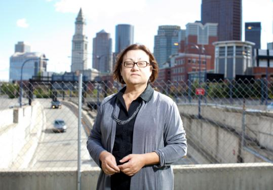 Mary Beaudry, Boston University professor, stood in front of the site of what was once a Boston brothel. Uncovered artifacts include a spittoon, carved bone toothbrushes, and a cosmetics jar.