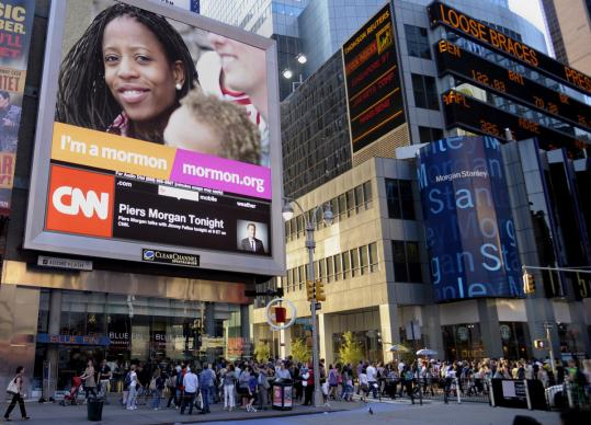 A Times Square billboard in New York is part of a Mormon ad campaign to counter negative attitudes toward the faith.