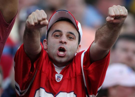 After the Patriots booted a second-quarter field goal, this fan did his part in contributing to the decibel level with a two-fisted shout.