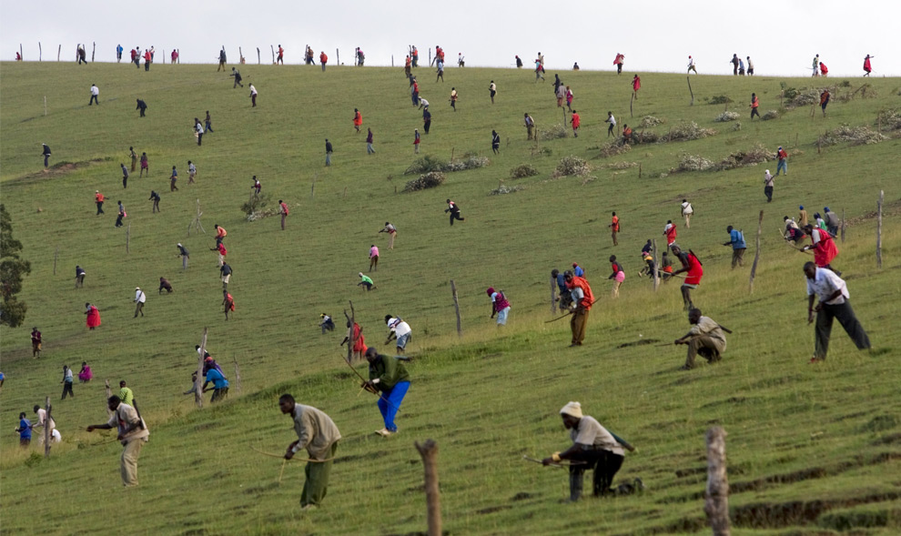 Maasai warriors cover a battle field as they clash with bows and arrows with members of the Kalenjin tribe in the Kapune hill overlooking the Olmelil valley located in the Transmara District in Western Kenya on March 01, 2008. The Massai, the Kalenjin and the Kisii tribes have recently clashed over ongoing land disputes that erupted after botched local elections during the general elections held in Kenya in December of 2007. Over twenty warriors from the tribes have been killed in bow and arrow battles near the borders of these tribes in the last couple of months.(Yasuyoshi Chiba/AFP/Getty Images)