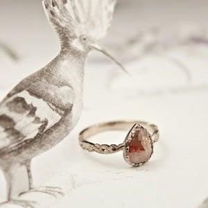 Image of opaque diamond 'tear drop' ring