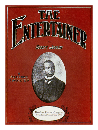Cover of sheet music for <cite>The Entertainer: a Ragtime Two-Step</cite> by Scott Joplin, with an oval black-and-white photograph of the African-American composer, published by the Theodore Presser Company, Bryn Mawr, Pennsylvania