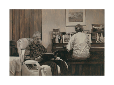 light sepia photograph of older woman playing a console piano with many pictures in frames on the top, older man sits in an armchair to her left, reading.