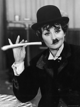 Lucy portraying Charlie Chaplin in a classic scene from her iconic T.V. series...