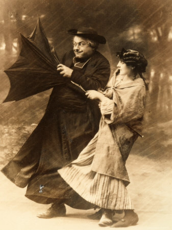 https://i2.wp.com/cache2.artprintimages.com/p/LRG/29/2955/NJPRD00Z/art-print/elderly-priest-and-young-woman-trying-to-hold-on-to-an-umbrella-turned-inside-out-by-a-gust-of-wind.jpg