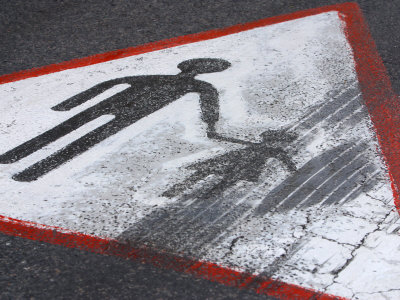 Paint Chipped and Tire Skid Mark on Yield Sign with Figure of Man Holding Hand of Little Girl Photographic Print