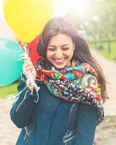 Portrait of a happy beautiful woman with balloons