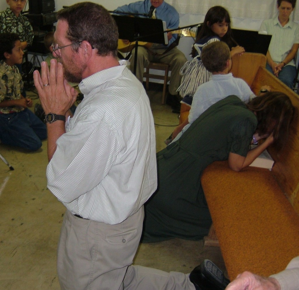 people praying at Mass
