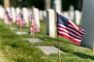flags on graves at cemetery