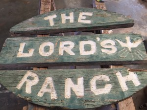 The old and weathered Lord's Ranch sign.