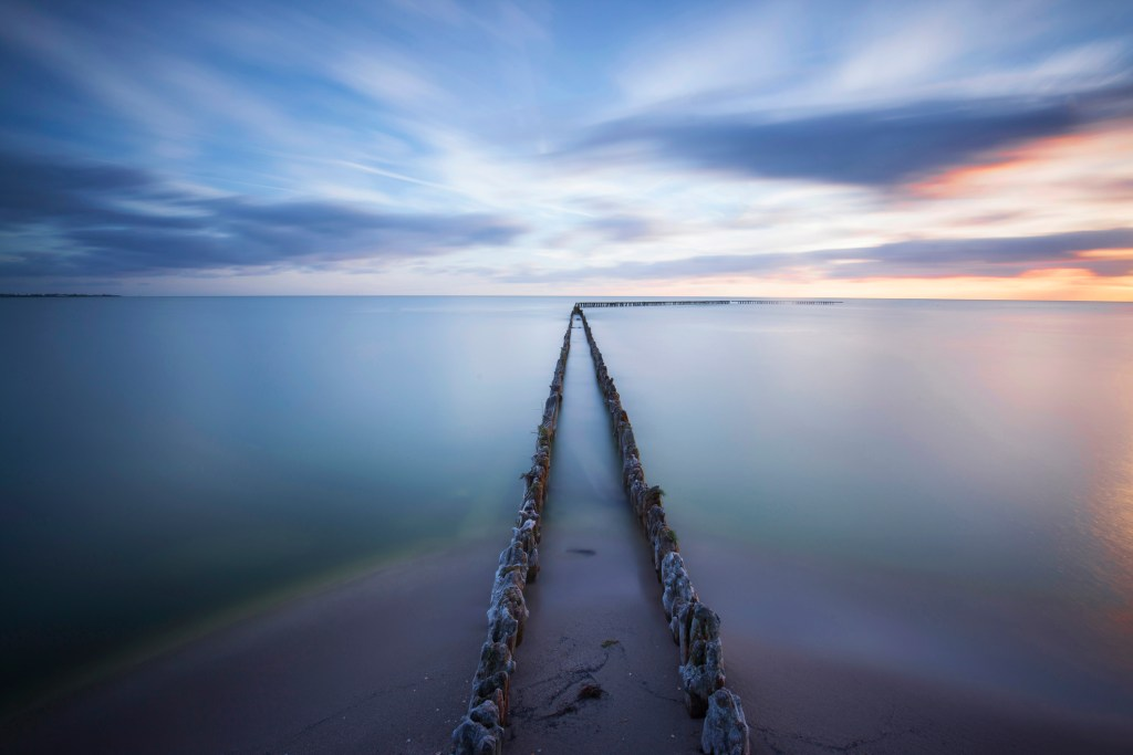 breakwaters lead to the horizon into infinity.