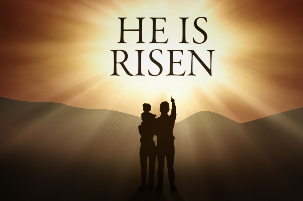 Three members of family are looking at the text of He is risen