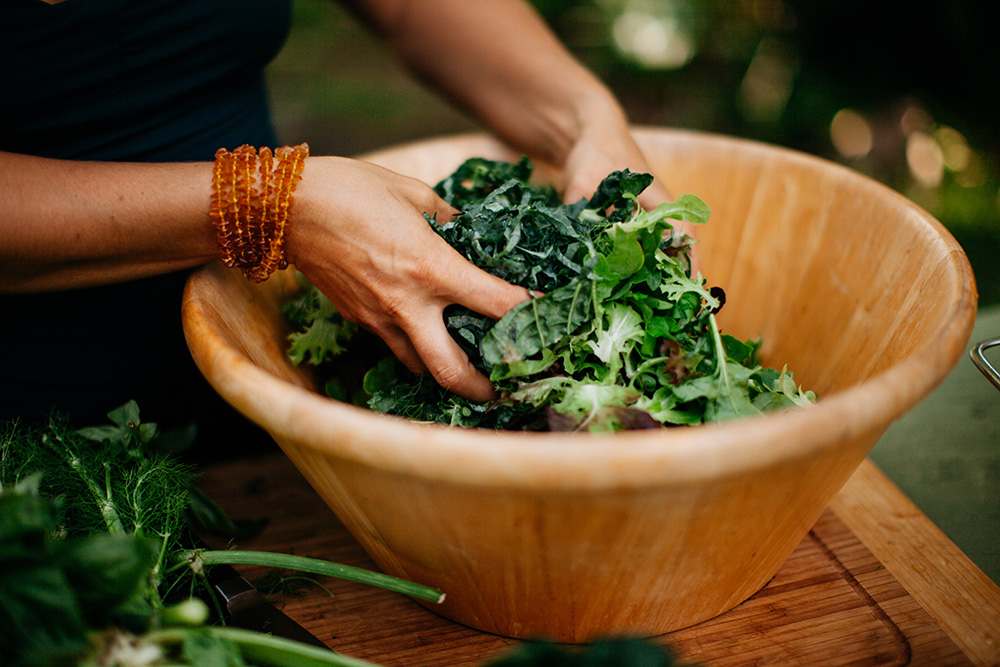 making a salad out of local organic ingredients on Maui with angel green
