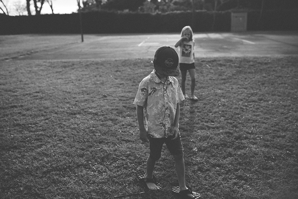 cruising basketball courts at paia bay for maui family photography.