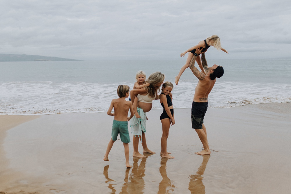 playful family photo in hawaii