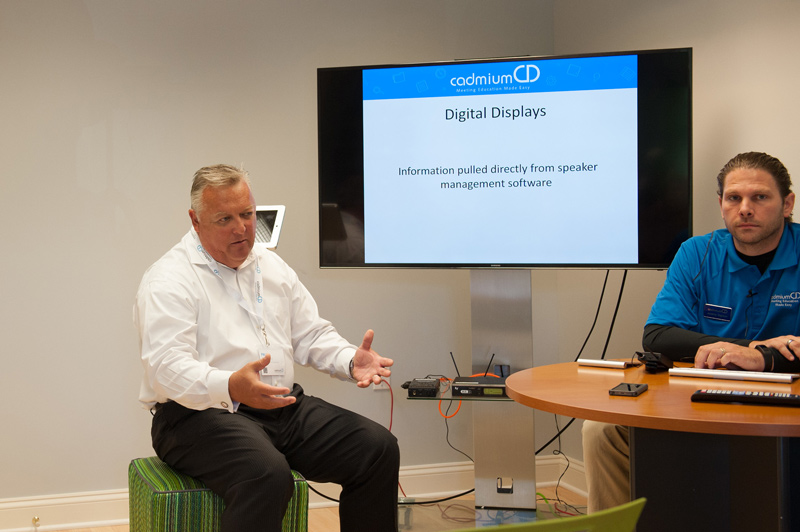 Paul Wedesky and Jeremy Sigmon explaining how digital displays can be enhanced by the right software.
