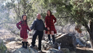 Photo of Desirea Haggard with her husband and daughter enjoying hike in the woods.