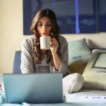 woman in grey jacket sits on bed uses grey laptop 935743 150x150 - Ocho maneras de protegerse online en el Día Internacional de Internet Seguro