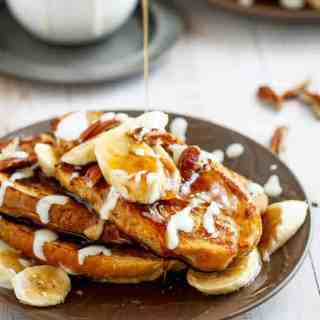 Banana Bread French Toast drizzled with a Cream Cheese Glaze | http://cafedelites.com
