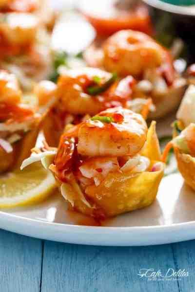 The ultimate appetiser! Garlic Prawn (Shrimp) Salad Wonton Cups with Sweet Chilli Sauce   https://cafedelites.com