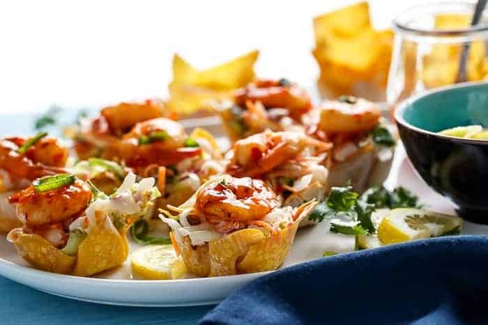 The ultimate appetiser! Garlic Prawn (Shrimp) Salad Wonton Cups with Sweet Chilli Sauce | https://cafedelites.com