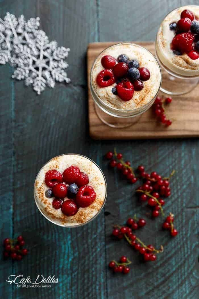 With a gingerbread cookie base and sugared berries as a topping, these mini no bake eggnog cheesecakes -- parfaits or trifles -- will get you through Christmas and future Thanksgiving dinners | http://cafedelites.com