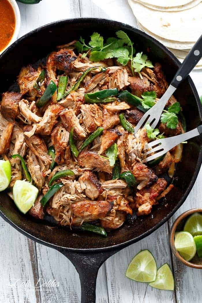 Crispy Slow Cooker Carnitas (Mexican Pulled Pork) so tender an falling apart smothered in so much flavour, you won't be able to put your forks down! | http://cafedelites.com