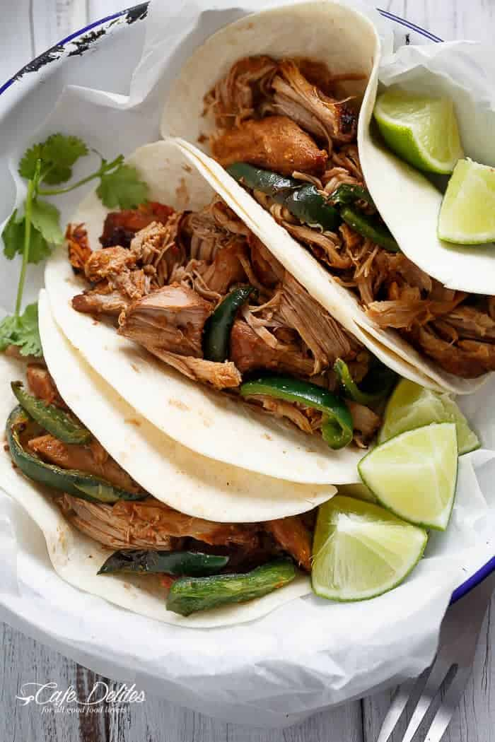 Crispy Slow Cooker Carnitas (Mexican Pulled Pork) so tender an falling apart smothered in so much flavour, you won't be able to put your forks down! | https://cafedelites.com