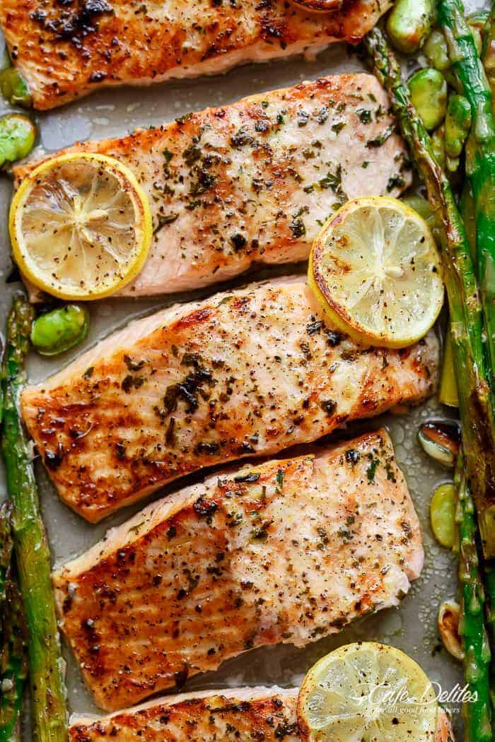 Lemon, garlic and parsley are infused in One Pan Lemon Garlic Baked Salmon + Asparagus ready in only 10 minutes without any marinading! | https://cafedelites.com