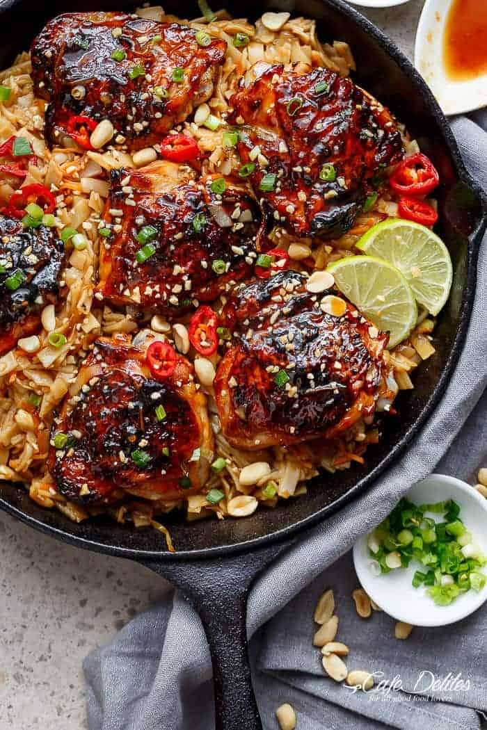One Skillet Thai Chicken Thighs + Noodles! A sticky, Thai inspired chicken recipe served with Thai Rice noodles, cooked in one skillet! | https://cafedelites.com