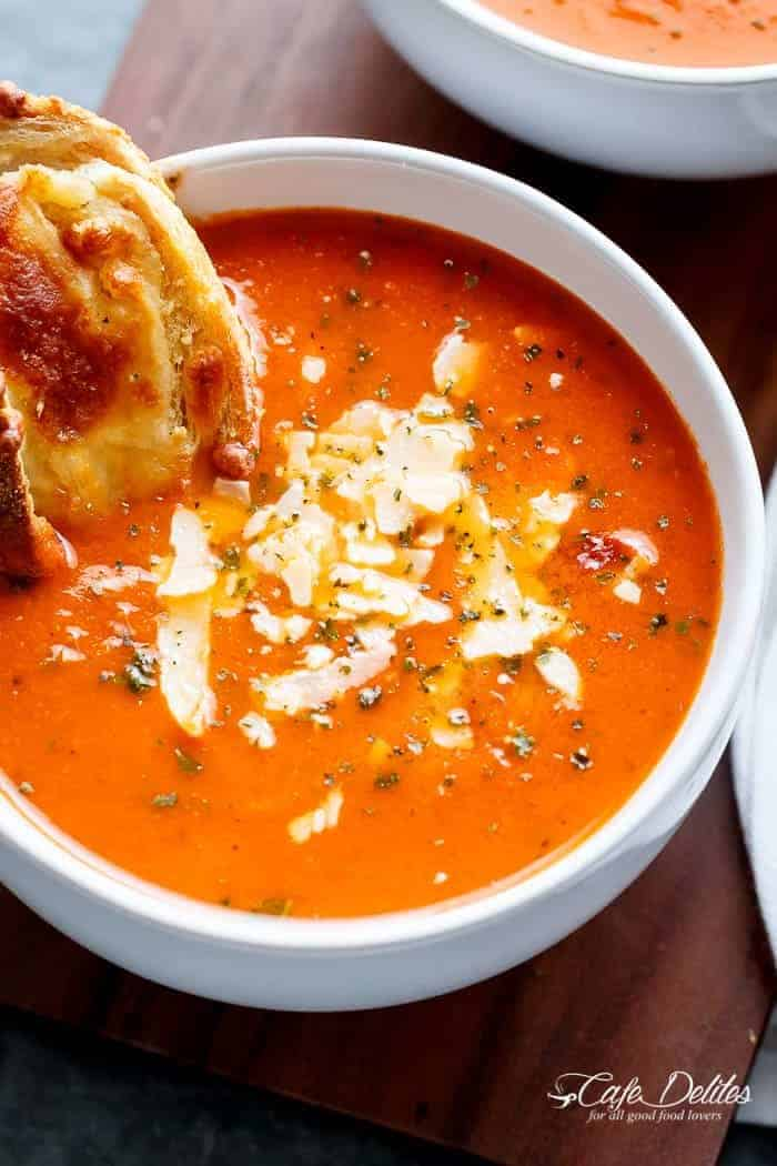 A Creamy Roasted Tomato Basil Soup full of incredible flavours, naturally thickened with no need for cream cheese or heavy creams!   http://cafedelites.com