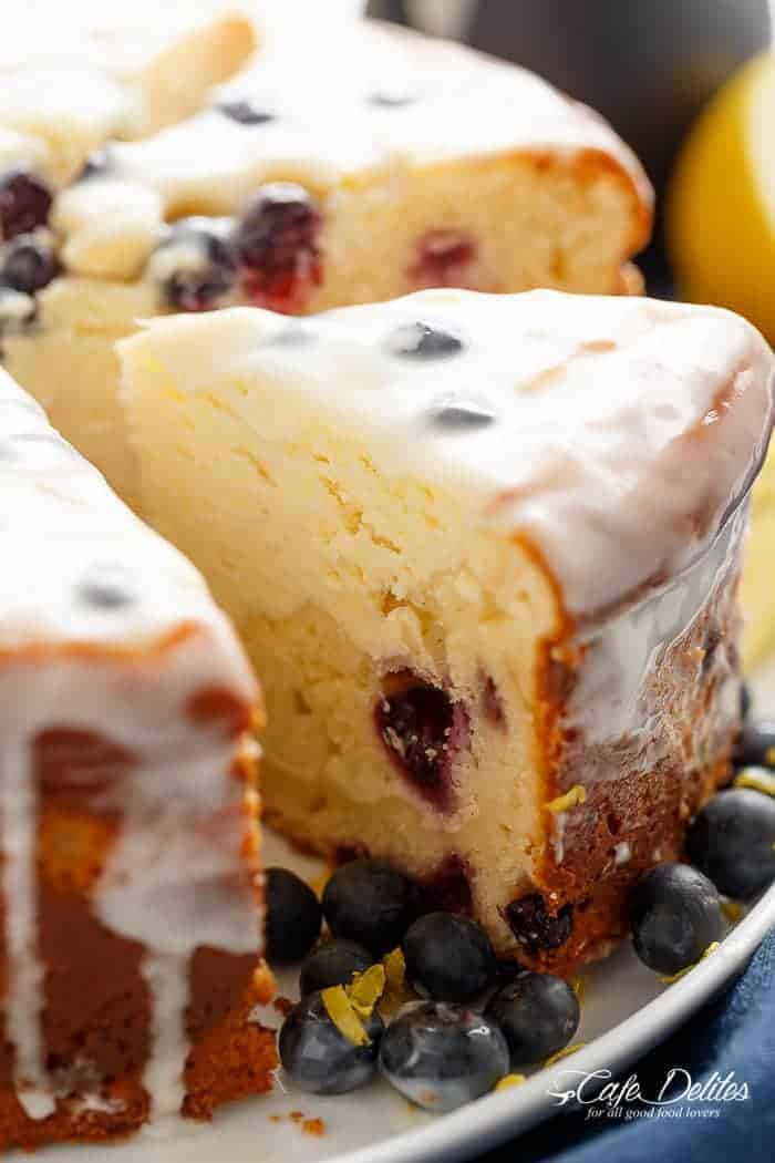 Blueberry Lemon Cheesecake Cake with a Lemon Cream Cheese Glaze to kick start your season! Baked in the one pan Easy to make with no layering!   https://cafedelites.com