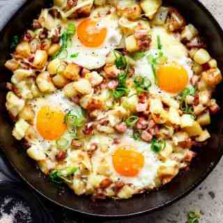 Cheesy Bacon and Egg Hash for breakfast, brunch, lunch or dinner! Easy to make and ready in 30 minutes -- all in one skillet or pan!   http://cafedelites.com