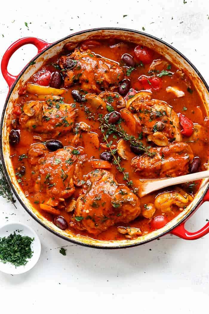 Slow cooked Chicken Cacciatore, with chicken falling off the bone in a rich and rustic sauce is simple Italian comfort food at its best. | https://cafedelites.com