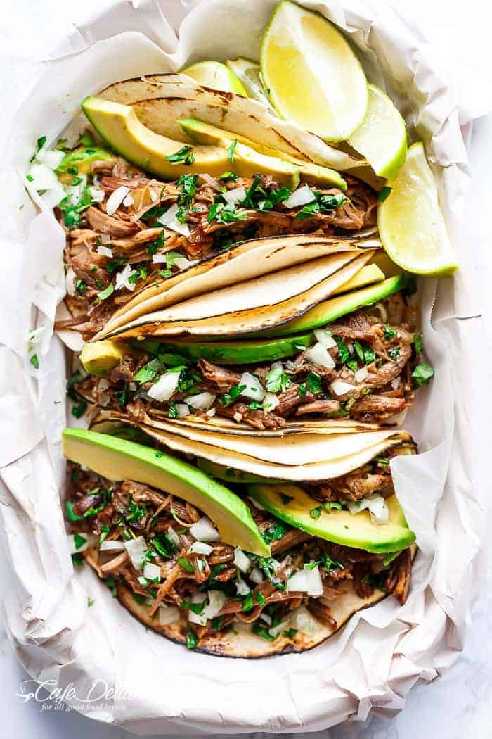 Slow Cooker Barbacoa Short Ribs full of barbacoa flavours! Meat so tender it falls off the bone before being stuffed into Taco's and served with Avocado! | https://cafedelites.com