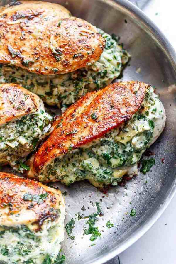 Spinach Artichoke Stuffed Chicken is a delicious way to turn a creamy dip into an incredible dinner! Serve it with a creamy sauce for added flavour!   https://cafedelites.com