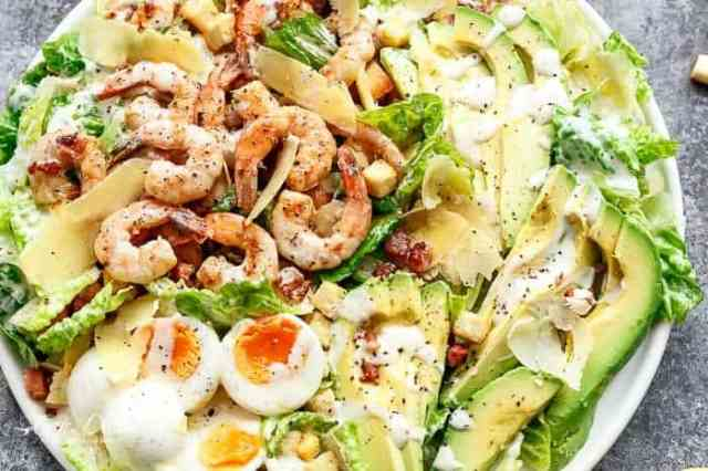Grilled and Skinny Lemon Garlic Shrimp Caesar Salad with a lightened up creamy Caesar dressing is a complete meal in a salad and a family favourite! | https://cafedelites.com
