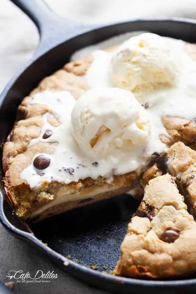 Cheesecake Stuffed Chocolate Chip Skillet Cookie | https://cafedelites.com