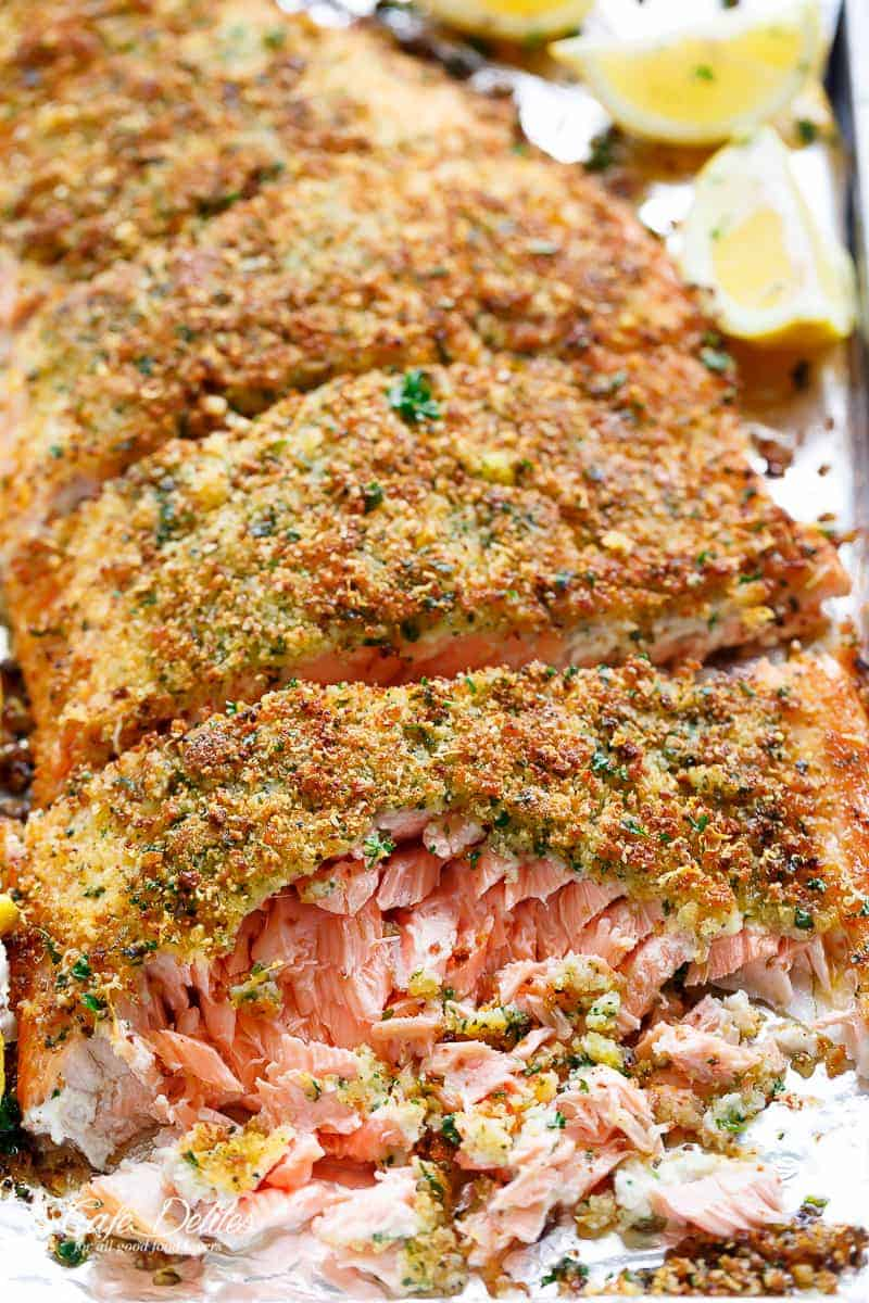Tender fall apart oven baked salmon with a crispy parmesan crumb topping!