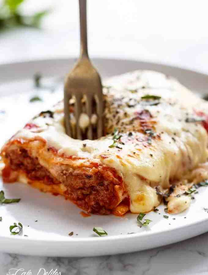 These Easy Lasagna Stuffed Burritos are a family favourite! Stuffed with lasagna meat sauce, lasagna flavours, and plenty of melted mozzarella cheese!   http://cafedelites.com