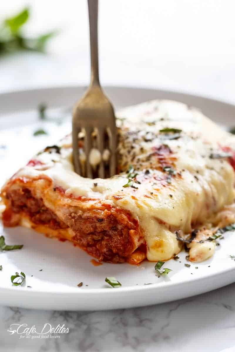These Easy Lasagna Stuffed Burritos are a family favourite! Stuffed with lasagna meat sauce, lasagna flavours, and plenty of melted mozzarella cheese! | http://cafedelites.com