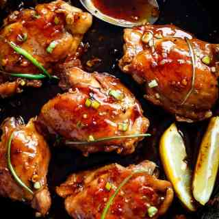 Garlic Teriyaki Chicken Thighs are cooked right on the stove without needing an oven! Better than any store bought teriyaki, this recipe is a family favourite! | http://cafedelites.com