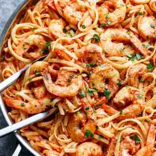 Pasta gets a delicious make over with this 15-Minute Creamy Tomato Garlic Butter Shrimp! A quick and easy flavourful dinner in minutes! | http://cafedelites.com