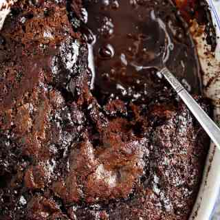 Hot Fudge Chocolate Pudding Cake is extremely easy to make! A rich chocolate fudge sauce forms underneath a layer of chocolate cake while baking, by itself! | http://cafedelites.com