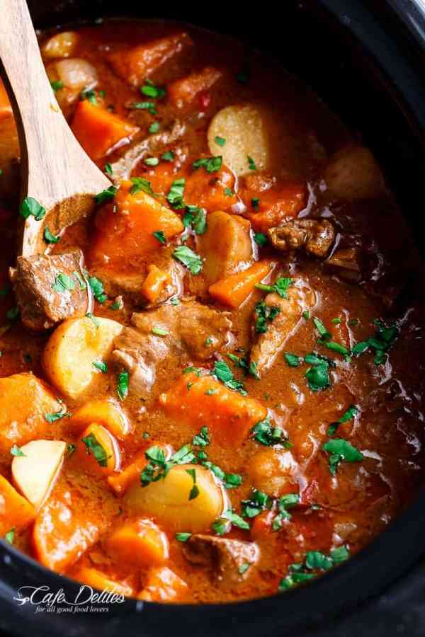 Slow Cooker Beef & Sweet Potato Stew is easy to throw together and filled with fall apart, tender beef pieces and sweet potato! | https://cafedelites.com