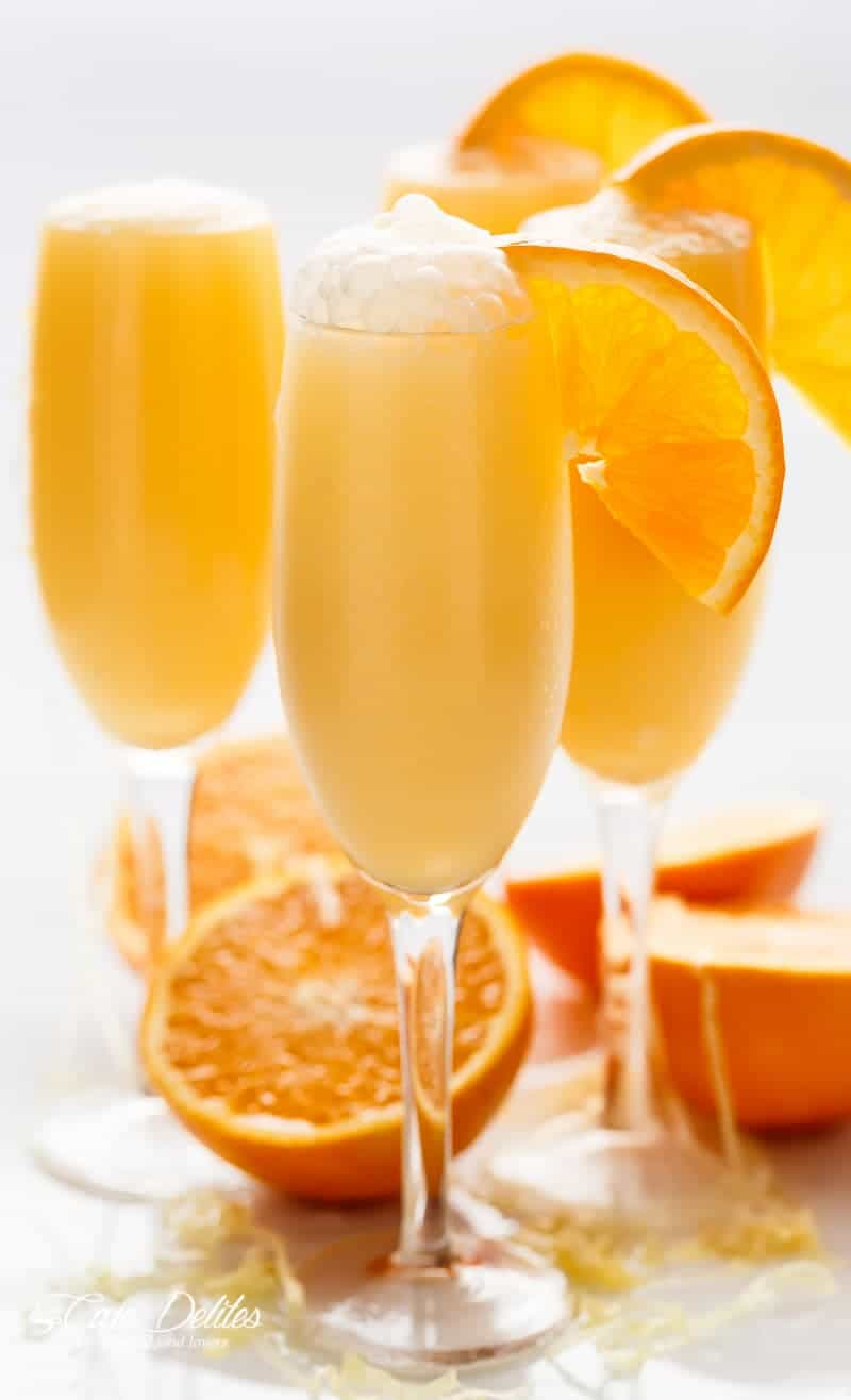 Orange Creamsicle Mimosas is the perfect refreshing beverage to add to your breakfast or brunch menu! A champagne cocktail that tastes just like a Creamsicle! | https://cafedelites.com