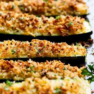 Parmesan Crusted Zucchini are easy to make and are one of THE best ways to enjoy zucchini! Crispy and crunchy, the perfect side dish OR snack!   https://cafedelites.com